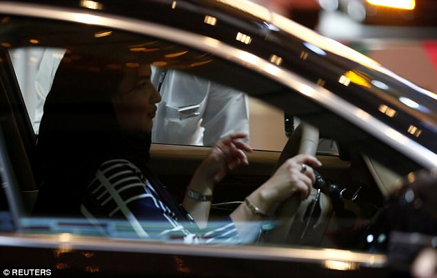 The bride's father had demanded that his daughter get a driving license and a car when Saudi Arabia lifts its ban on women driving in June 2018 (file photo of a woman in the driver's seat of a car in a showroom in Riyadh, Saudi Arabia)