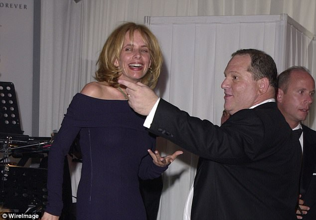 Dam story:Rosanna Arquette says she met Weinstein in a hotel room and he asked her to give him a massage then tried to have her touch his erect penis (Arquette and Weinstein above in 2001)