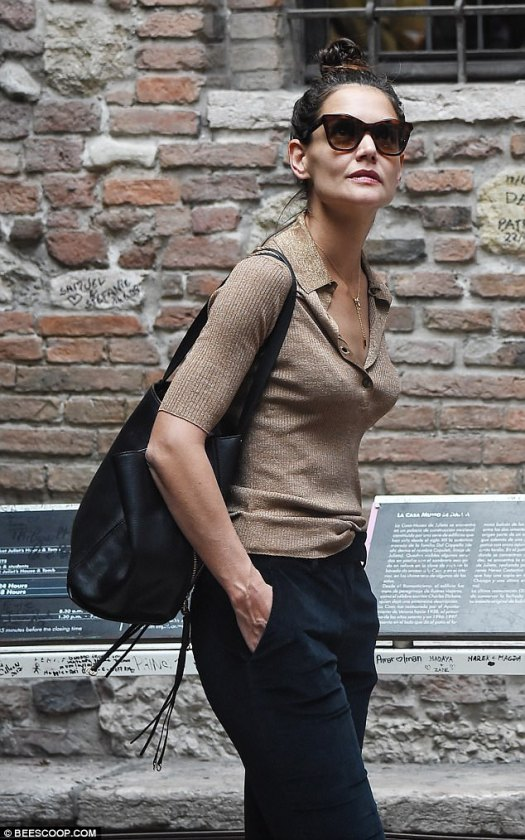 Romance for one: Just last week, Katie was spotted in Verona, Italy, doing some sightseeing on her own