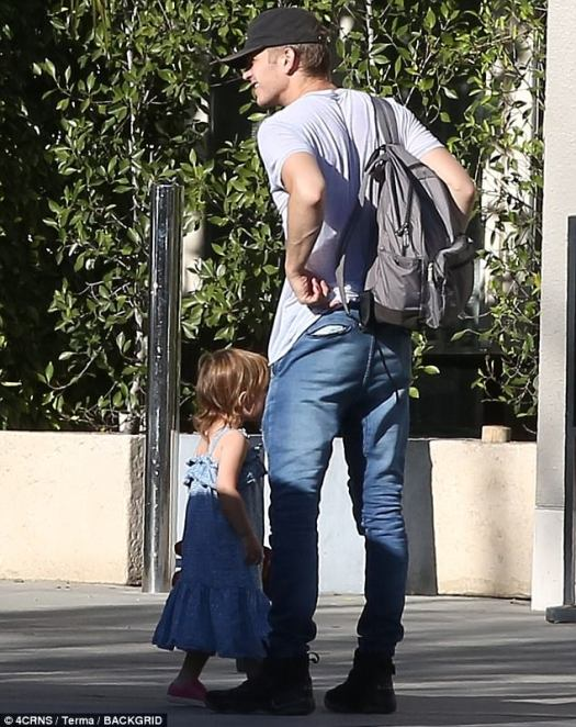 Ready for anything: The Life As A House actor kept a slate colored backpack filled with daddy essentials on stand-by as he and his toddler walked off together