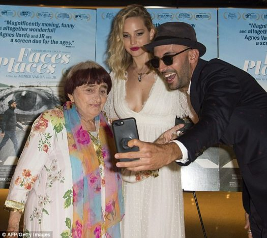 Well suited! Varda's co-creator looked sharp in a navy suit and chic chapeau as he helped the duo take photos
