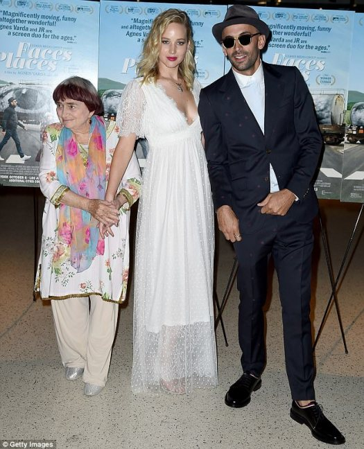 Who R you? Agnes and JLaw were joined by the Belgian-born film vet's creative collaborator JR