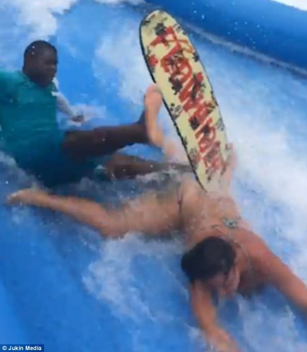 She charged straight between his legs, knocking him off his feet and they both went shooting down the slide in Jamaica
