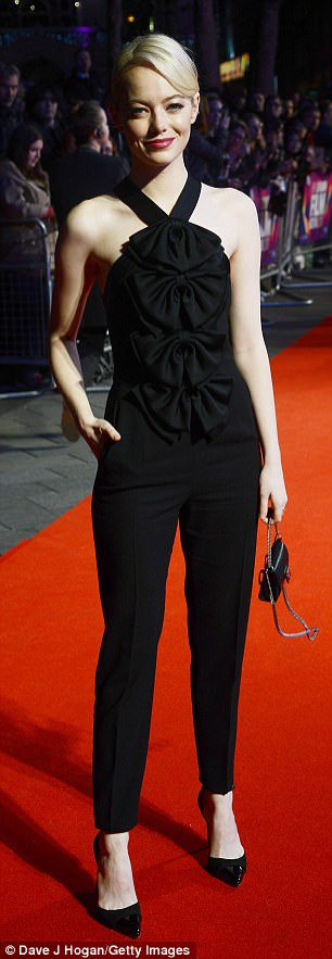 Work it:The blonde beauty rocked a simply-yet-chic look, showing off her slim figure in a black Givenchy halterneck jumpsuit