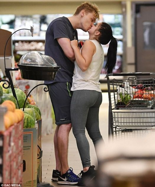 Kissing in the produce aisle! Ariel Winter planted a smooch on Levi Meaden in a Los Angeles grocery store on Wednesday