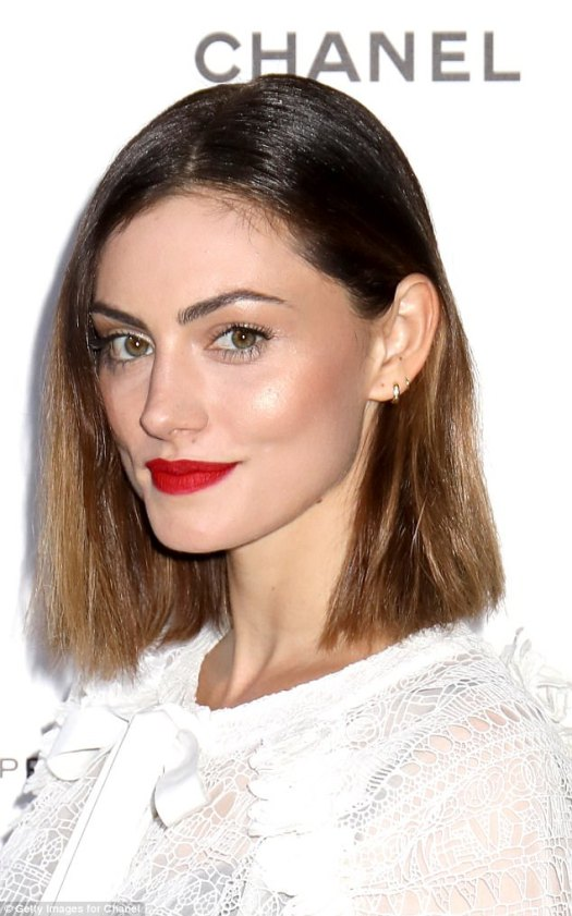 Bold:She kept her make up bold with a shimmery beige eye, flawless complexion and bright red lip