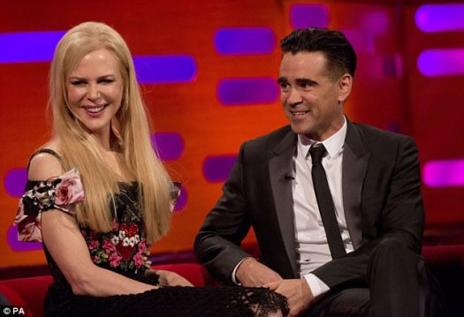 Radiant: The Oscar-winning actress, who turned 50 in June, looked impossibly youthful in a chic floral print bardot dress, with statement bow shoulder straps which showed off her slender midriff and toned arms as she chatted to the Irish TV host