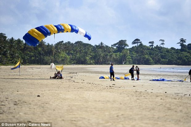 Skydivers were pictured landing safely on the Mission Beach site earlier in the day, before the incident occurred