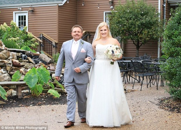 Ashleigh Patrice Reed, 26, walked with her father to her wedding ceremony at Cottleville Wine Seller, Missouri. All photos courtesy ofMindy Miles Photography