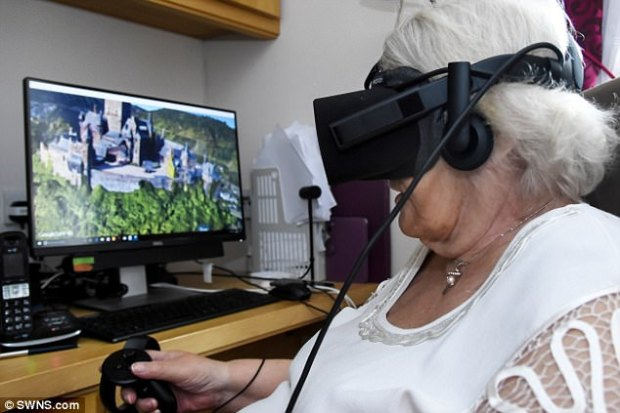 Mrs Howard, who suffers from spinal problems and arthritis, uses the virtual reality kit to 'visit' exotic destinations across the globe
