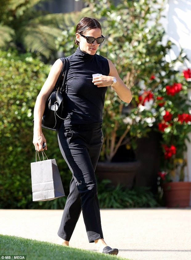 Understated: The actress looked ready for business in all black and her hair swept back in a bun