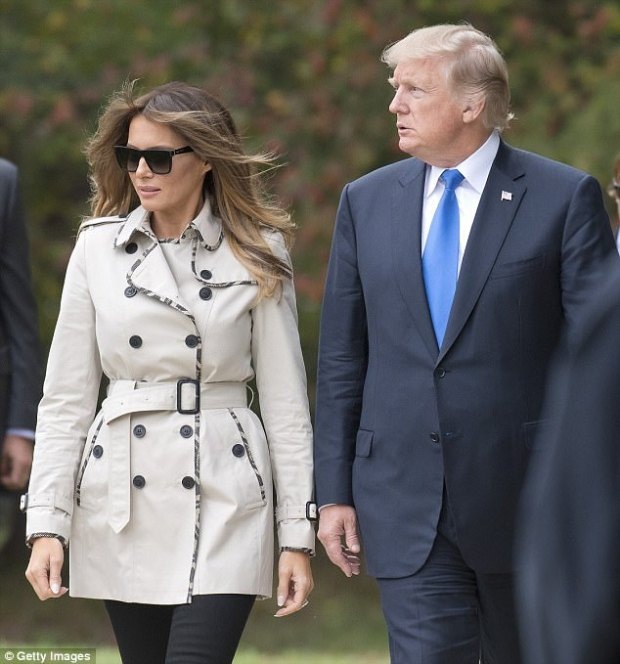 Windy: Melania opted to wear her long, golden brown hair down around her shoulders despite the breeze