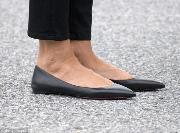 Practical choice: Melania traded her signature heels for practical black flats by Christian Louboutin for the visit