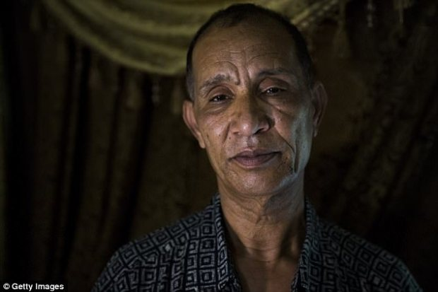 Her mother, Sawsan Gazzar, threw a shoe at the accused and said: 'I'll kill you!' (Pictured, father Mohmoud Hassanen)