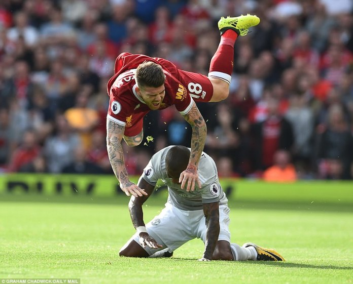 Alberto Moreno went flying over a challenge by Ashley Young as the two No 18s came together in midfield
