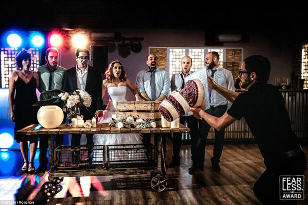 """Oopsy daisy"""" Dimitri Voronov of Norte de Espana perfectly captured the shocked expressions right before a three-layer wedding cake was about to fall to the floor"""