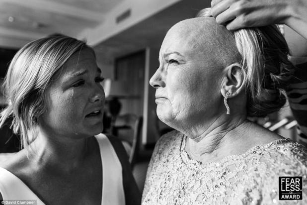 Emotional: David Clumpner of Montana photographed the tears streaming down one bride's face as she watched her mother have a wig placed on her head while battling breast cancer
