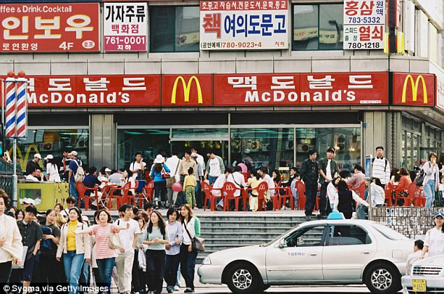 Raid: McDonald's offices in South Korea were raided on Wedneday after allegations children had suffered severe kidney damage after being infected by bacteria found in undercooked hamburgers served at their restaurants