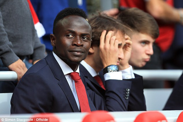 Sadio Mane watches his Liverpool team-mates against Manchester United from the stands