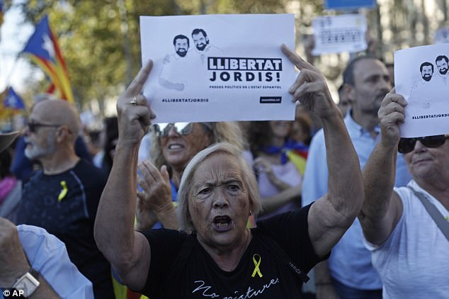 A protester holds sign reading 'Freedom for the two Jordis' during a march to protest against the National Court's decision to imprison civil society leaders,Jordi Sánchez and Jordi Cuixart