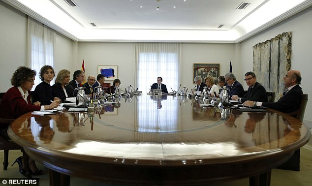 The Spanish government moved to activate a previously untapped constitutional article Saturday so it can take control of Catalonia. Pictured,Spain's Prime Minister Mariano Rajoy heads a special cabinet meeting at the Moncloa Palace in Madrid today