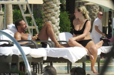 Loved-up: Kate Wright proved just that, as she enjoyed a trip to Dubai with footballer Rio Ferdinand where the duo proved just how happy they are while cosying up poolside, as she lay on his chest in an extremely sweet display