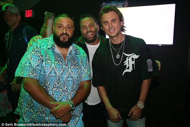 Troika: Khaled posed for a photo Saturday night alongside LIV owner David Grutman (center) and Kardashian satellite Jonathan Cheban (right)