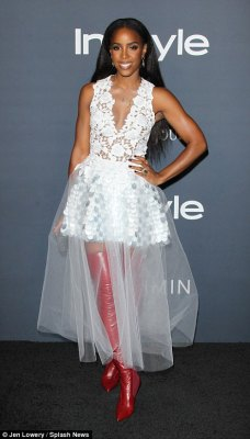 Beautiful in lace: Singer Kelly Rowland, 36, showcased her figure in a plunging white lace bodice with silver sequinned mini skirt and longer tulle overlay