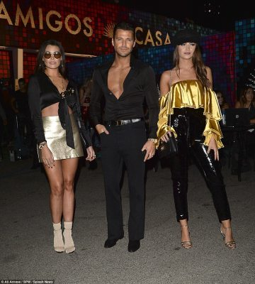 Three of a kind:Mark Wright - who is currently hosting the Extra TV show in the States - was joined at the party by his sisters Jessica and Natalya who also abided by the 70s theme