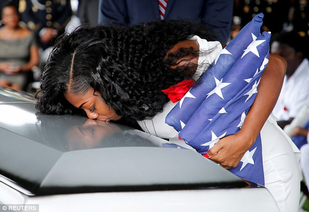 Myeshia Johnson kisses her husband's casket at his funeral in Hollywood, Florida, on October 21