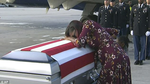 Myeshia Johnson is pictured greeting her husband's casket at Dover Air Force Base on October 17