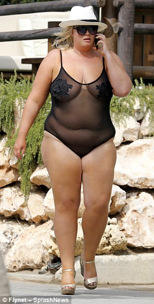 Bold: The TOWIE star, 36, left almost nothing to the imagination in the sheer one-piece, adorned with tiny flowers across the bust, as she took a phone call in the sunshine