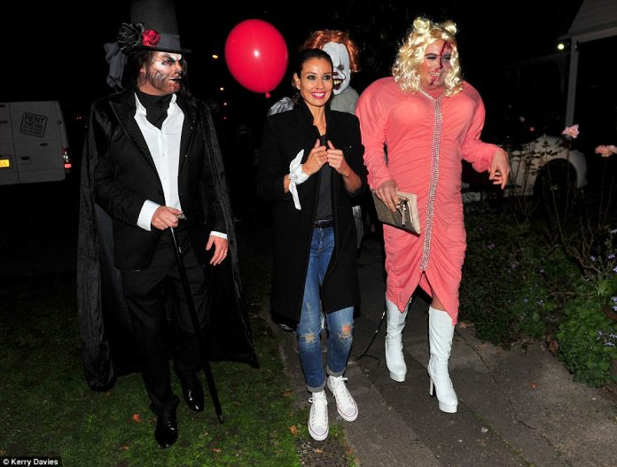 Making an arrival: Whilst Melanie Sykes appeared to have missed the memo somewhat and appeared to sport just a smidge of fake blood under her nose, Alan Carr went all out as he recreated Gemma Collins look at the ITV summer party