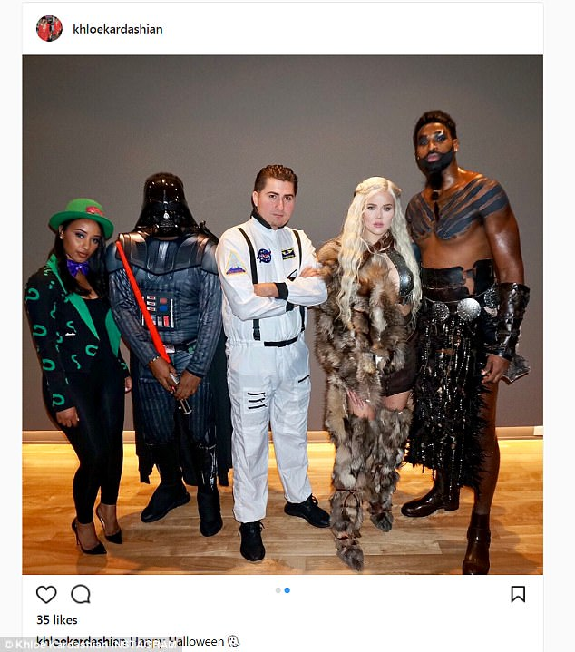 Showing off: The reality star was a dead ringer for the 'mother of dragons' as she rocked a silver chest peace featuring shoulder pads and cutout down the chest while joined by pals