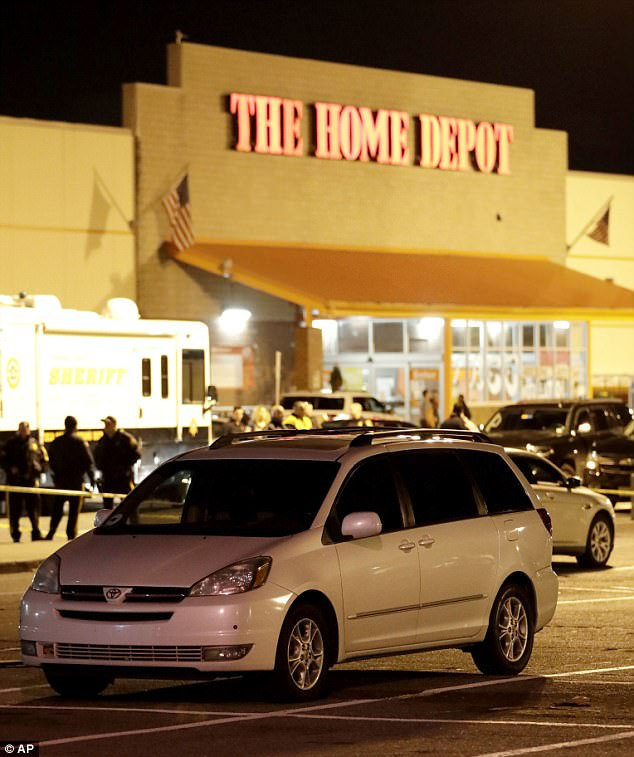 A vehicle is surrounded by a police perimeter in the parking lot of a Home Depot storein Passaic, New Jersey where authorities believe Saipov rented the truck used in the attack