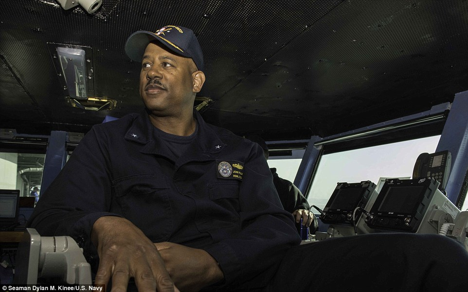 Rear Admiral John Fuller (pictured above in the flag bridge aboard the ship) Commander of Carrier Strike Group 1, will lead the Vinson. He said his strike group is 'ready' and in a direct message to Kim said: 'He knows the capabilities we have'