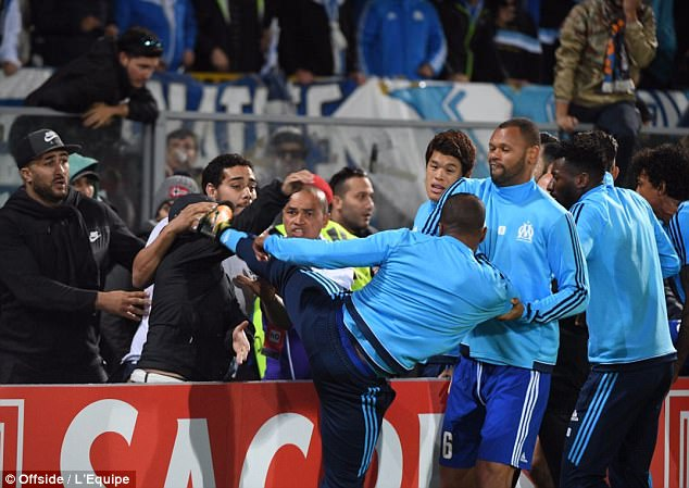Patrice Evra kicked a Marseille fan in the head after being confronted before the game