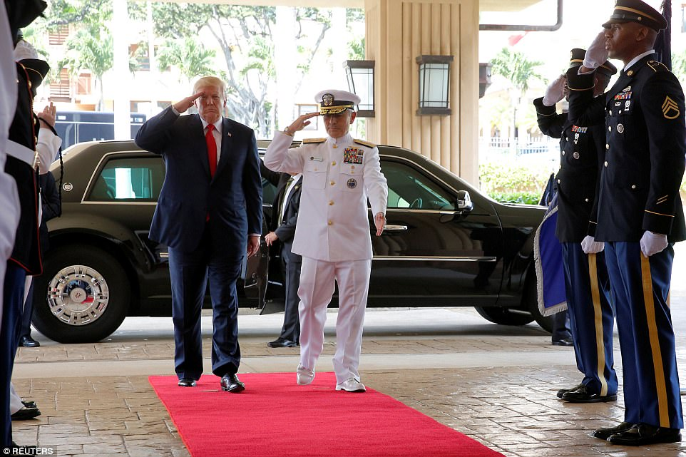 President Trump is welcomed by US Navy Admiral Harry Harris, commander of United States Pacific Command, at its headquarters in Aiea, Hawaii