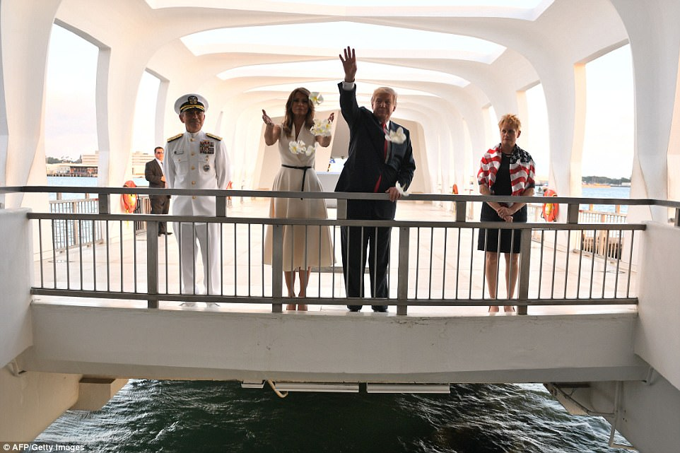 The president and the first lady throw flowers during their visit to the USS Arizona Memorial on Friday  in Honolulu. Admiral Harris and his wife Bruni Bradley accompanied the Trumps