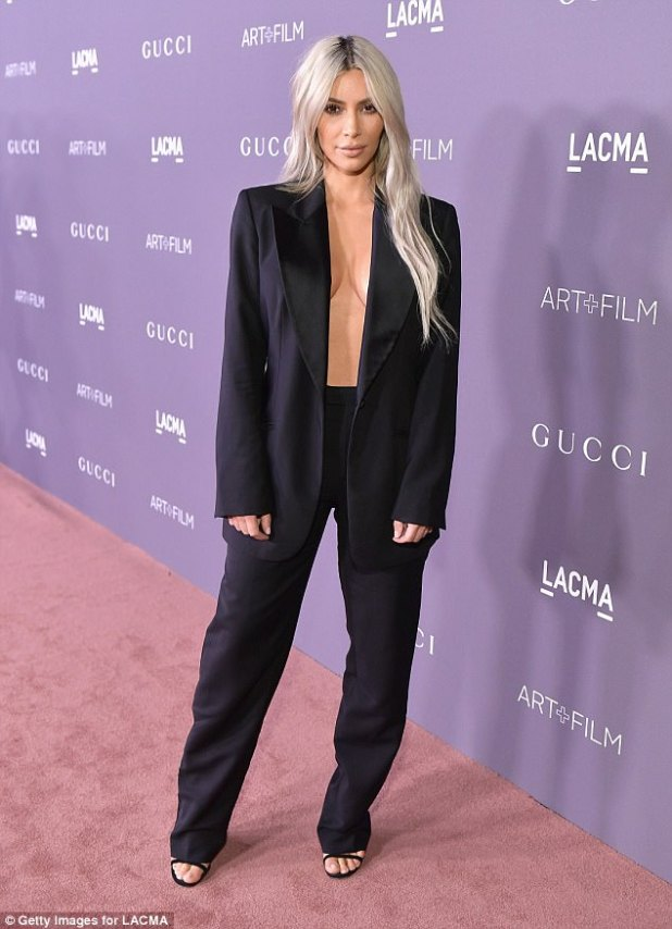 Wow factor: Kim Kardashiangave fellow attendees quite the eyeful as she showed up shirtless under a suit at the LACMA Art + Film Gala in Los Angeles on Saturday night