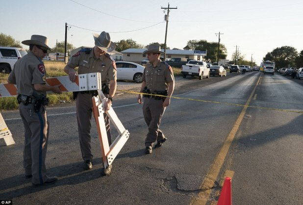 Texas state troopers erect a barricade to control traffic near the First Baptist Church of Sutherland Springs after the fatal shooting