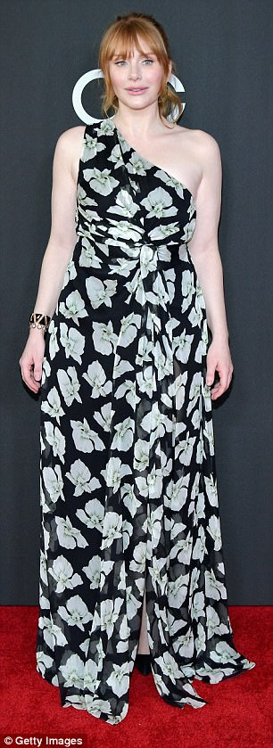 Flower power: The actress wore a sleeveless dress with asymmetrical neckline. The floral-patterned number was gathered slightly at the waist and fell to the floor in a full skirt