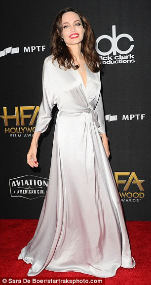 Honoree: She wore scarlet red color on her finger and toe nails and added a pair of towering shiny silver heels