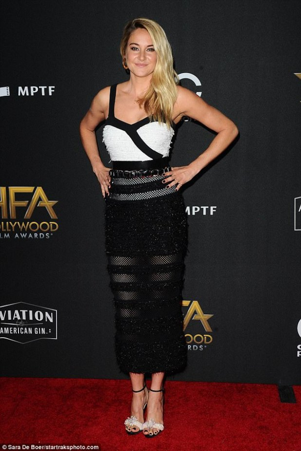 Shailene Woodley, 25, wore a sleeveless dress that paired a black and white bodice with a calf-length skirt with cut-outs andadded a chunky chain belt and embellished white sandal heels