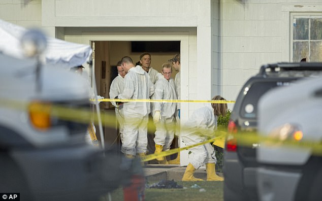 Investigators work at the scene of a deadly shooting at the First Baptist Church in Sutherland Springs, Texas, Sunday