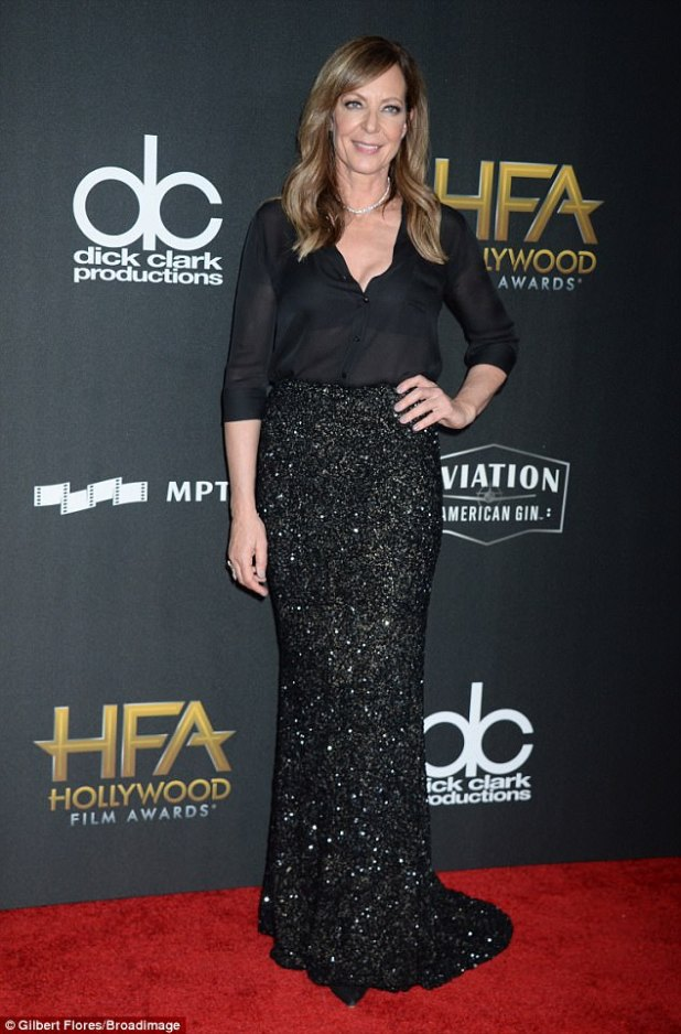 Glittery: Allison Janney, 57, paired a black blouse with a black sequinned full-length skirt. The actress, left the top buttons on her blouse undone and wore a stunning diamond necklace