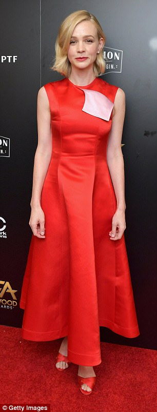 Winsome: Carey Mulligan, 32, was eye-catching in a red sleeveless dress with matching satin heels tied with ribbons at the heels