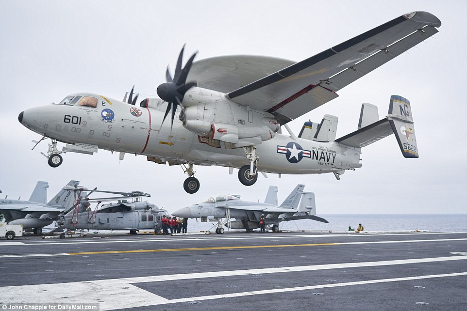 Also on board is a squadron of E-2C Hawkeye early warning aircraft - designed to detect jets, ships and other vehicles from long distances