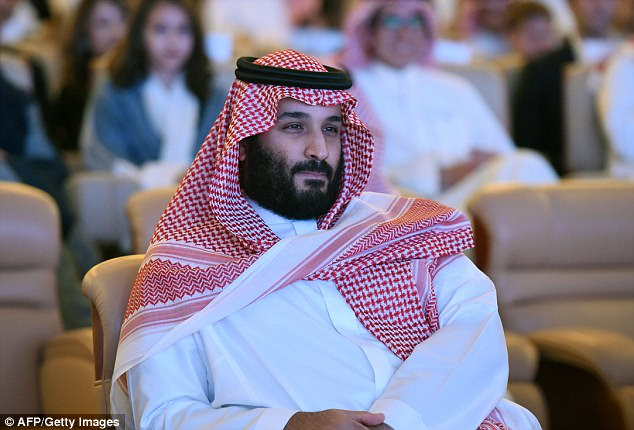 Strongman: Saudi Crown Prince Mohammed bin Salman, seen as he attended a glittering investment conference in the hotel now being used as a prison, ordered in the mercenaries, the source claimed, and takes part in interrogations personally