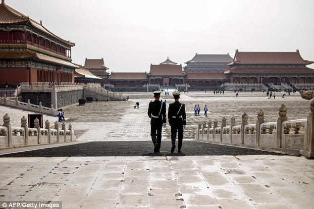 In this photo taken on October 31, 2017, Chinese paramilitary guards walk in The Forbidden City in Beijing